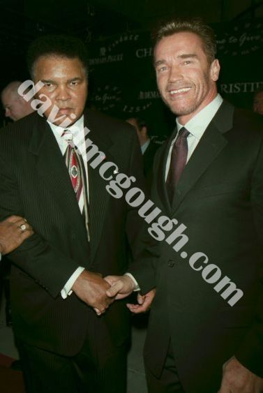 http://www.davidmcgough.com/photos/Muhammad%20Ali%20and%20Arnold%20Schwarzenegger%202000,%20NYC..jpg